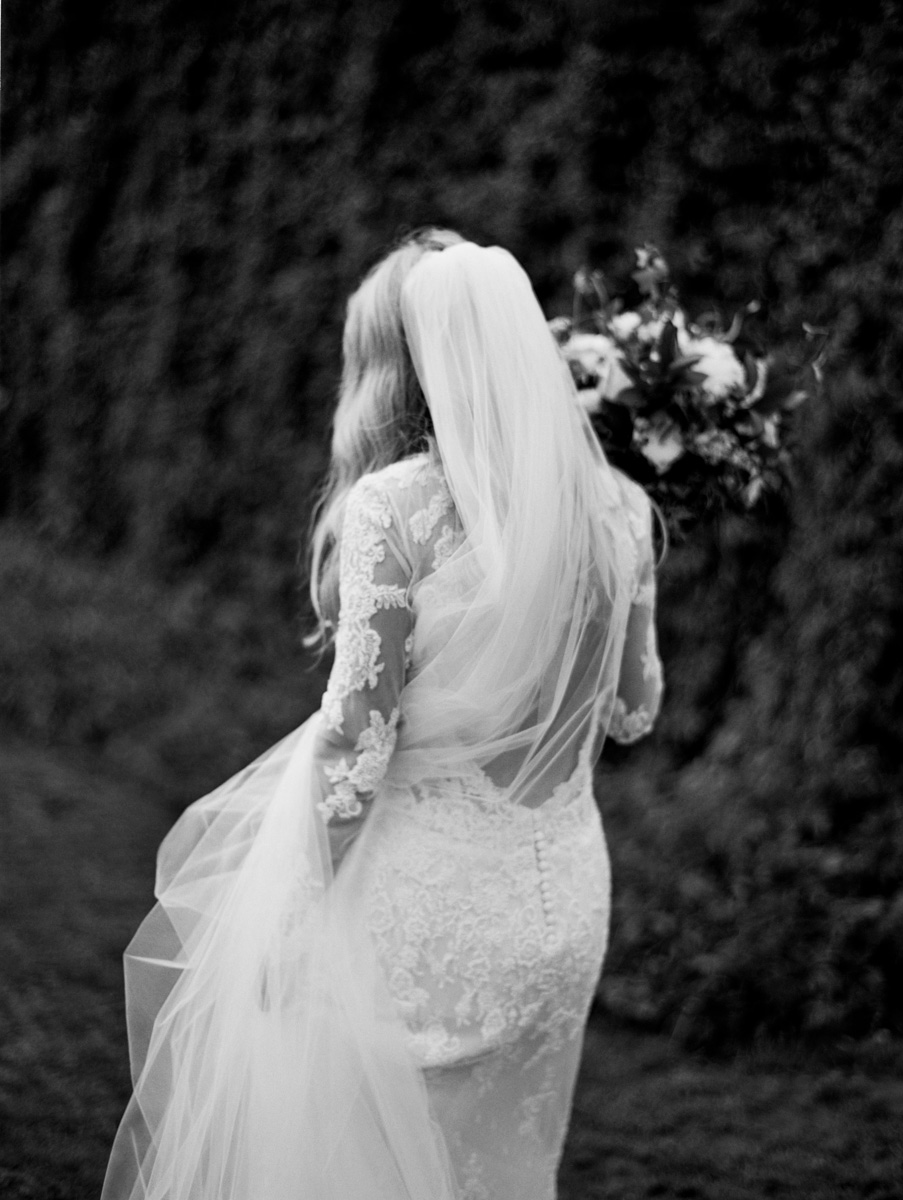 Mandalay House and Garden wedding Adelaide Bride walking with back of dress