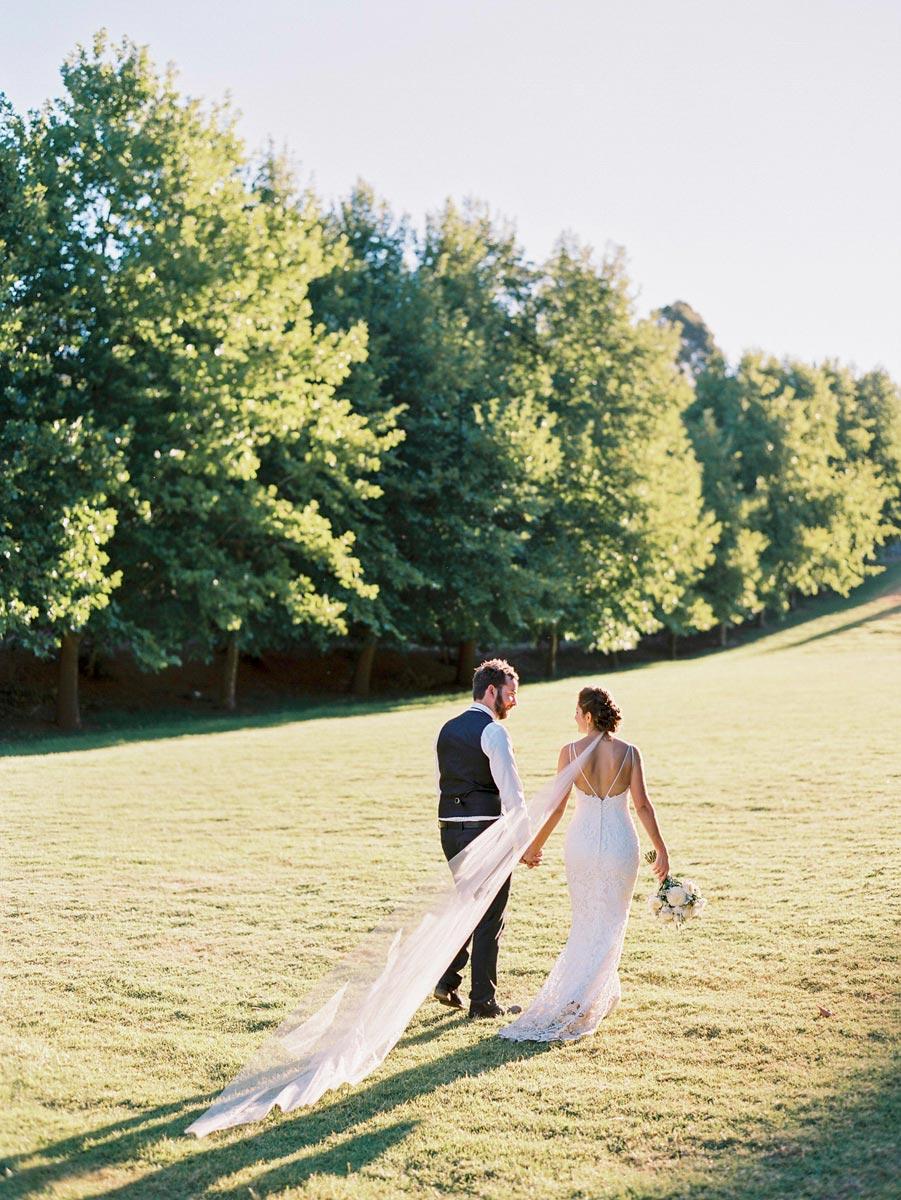 Glen Ewin Estate Wedding Couple walking long veil