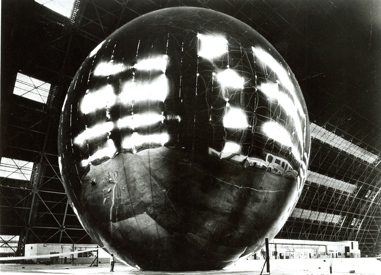 Project Echo  was the first passive communications satellite experiment. Two balloons were launched in 1960 and 1964 and floated into low Earth orbit. Communications signals, broadcast from Jet Propulsion Laboratory in Pasadena, bounced off Echo's reflective metallic surface and were then received at Bell Labs in New Jersey.