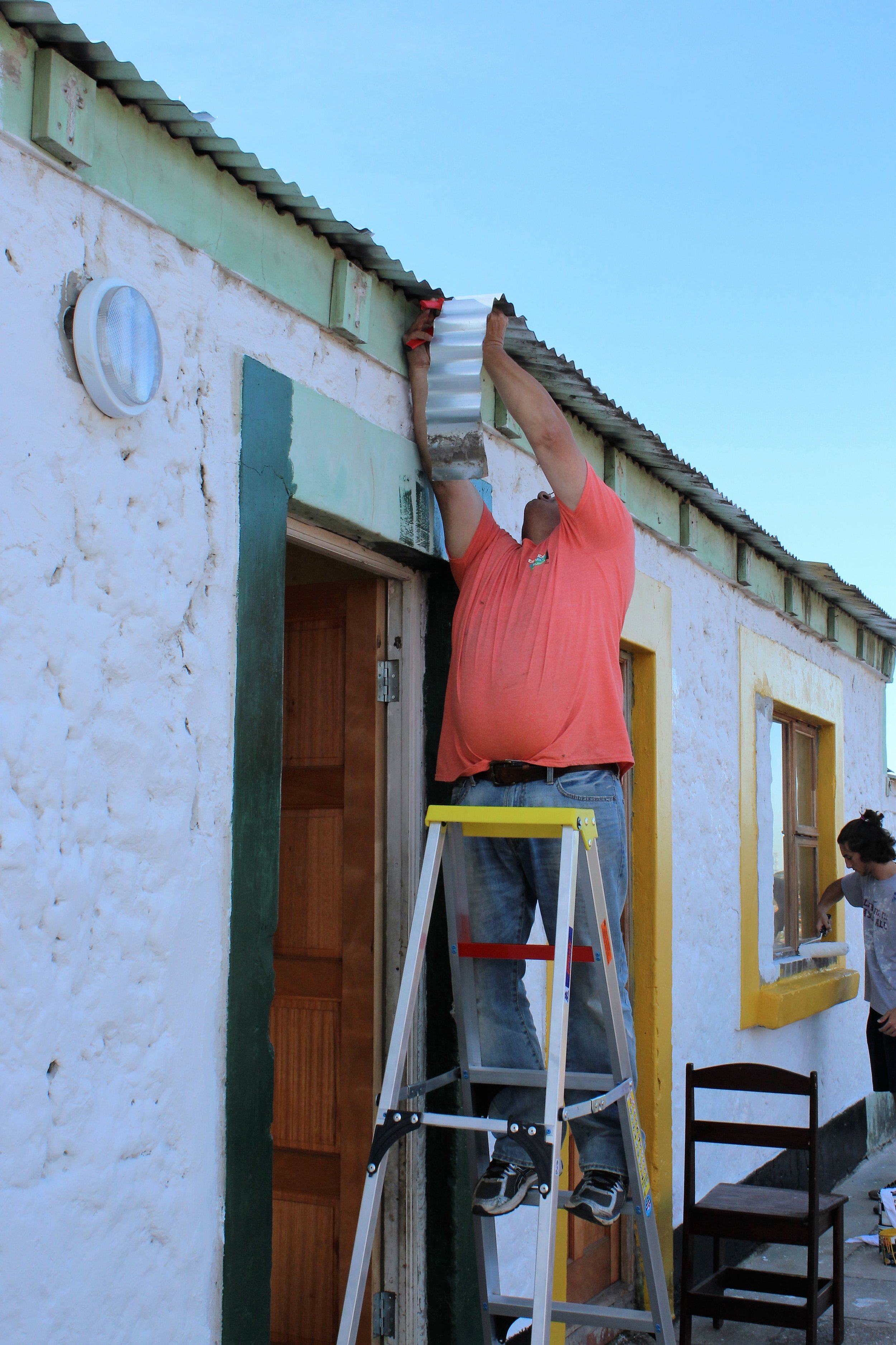 Mike Crosby working on gutters