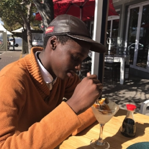 Alison, One Life South Africa director, celebrated Aman's scholarship with him with dessert.