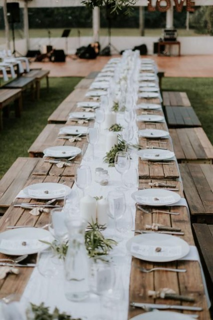 Timber trestle tables and timber benches. -