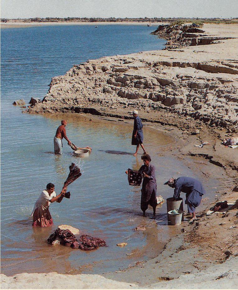 Fabric being washed in the river, Sindh. Source: Sindh Jo Ajrakh, Noorjehan Bilgrami