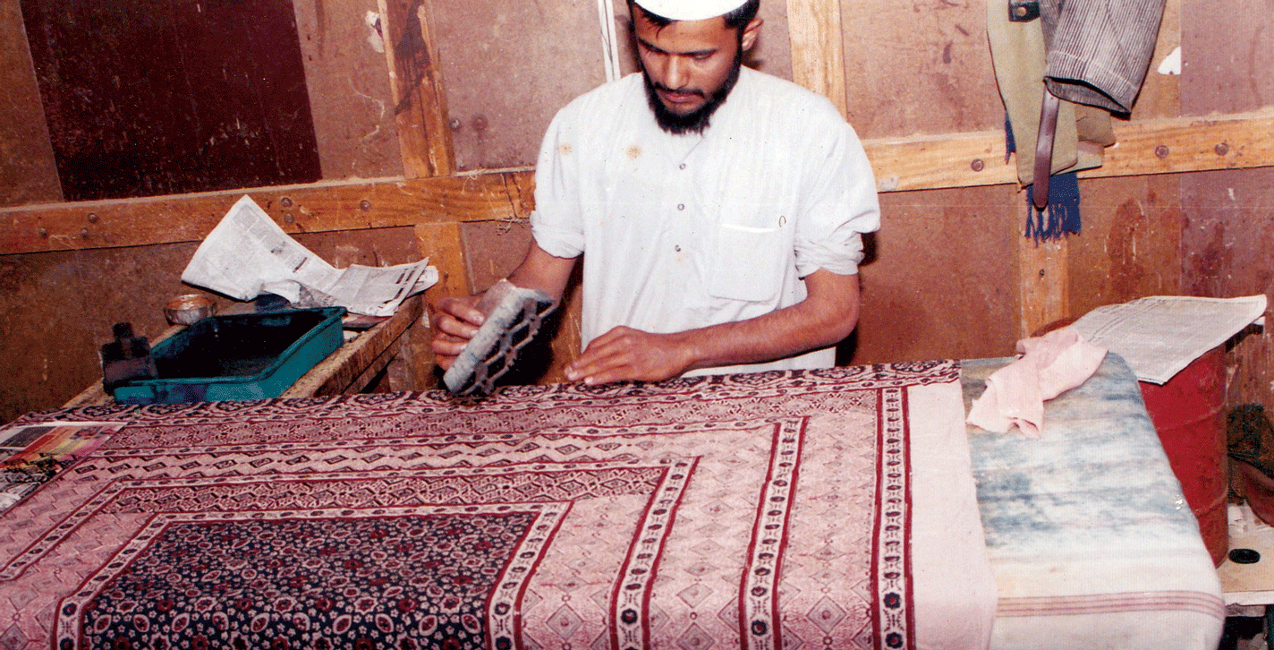 Printing of an Ajrakh bedspread; preparation of Ajrakh is a 12-16 step process