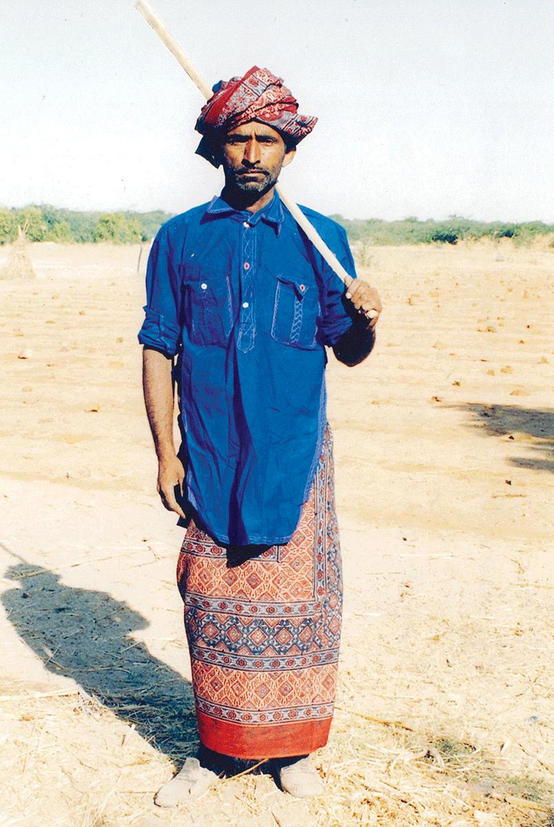 Maldhari man wearing Ajrakh lungi and turban in Banni