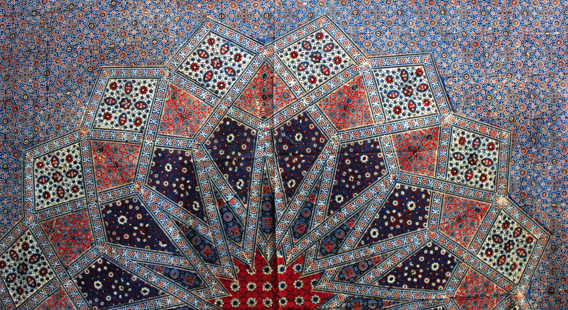A bedspread's central pattern showing traditional Ajrakh motifs combined in a new way