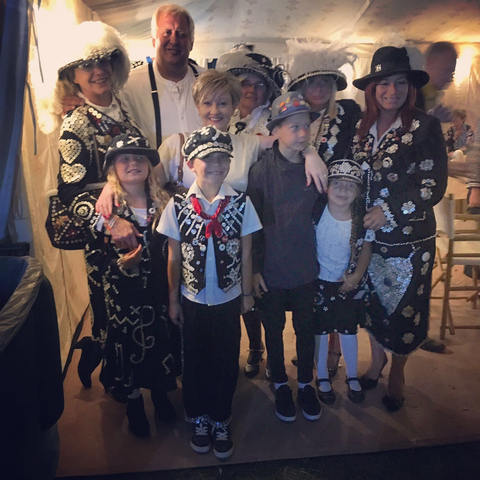 Group shot left to right back row Diane Gould, Pearlyking Jim, Pearly Queen Michelle, Pearly Queen Sherida, Pearly princess Karan. Front row LtoR Pearly Princess Lillie Bliss, Pearly Prince Cain, Pearly photographer Devon and Pearly princess Trinity. The lovely lady in the centre is the landlady of the Dublin Castle Samantha.