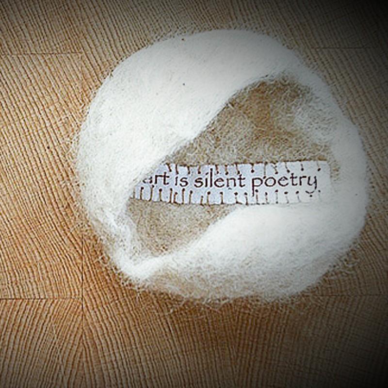 hand-made wool felt, paper, thread