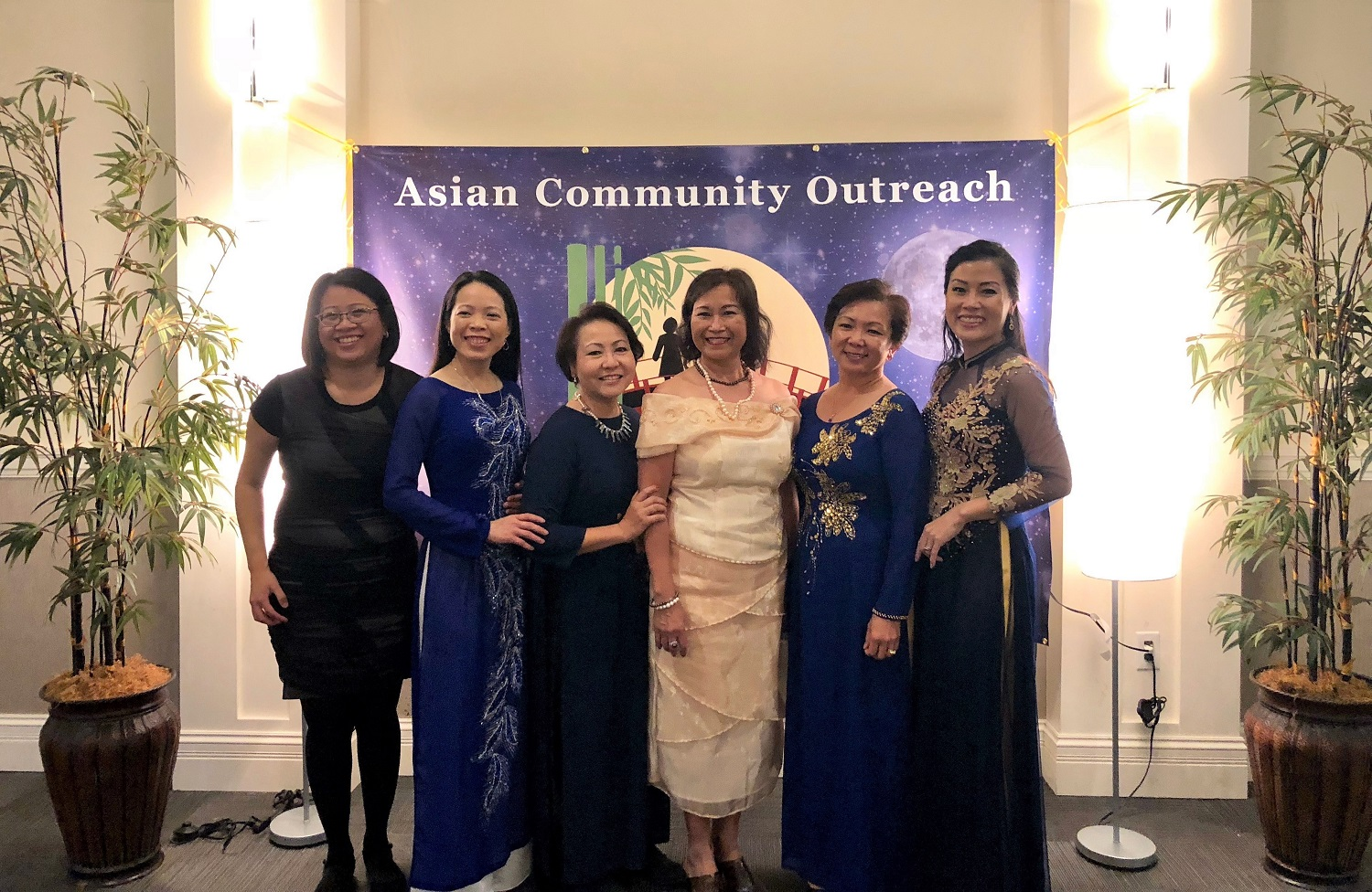 Crystal Bui, left, with Asian Community Outreach board members.