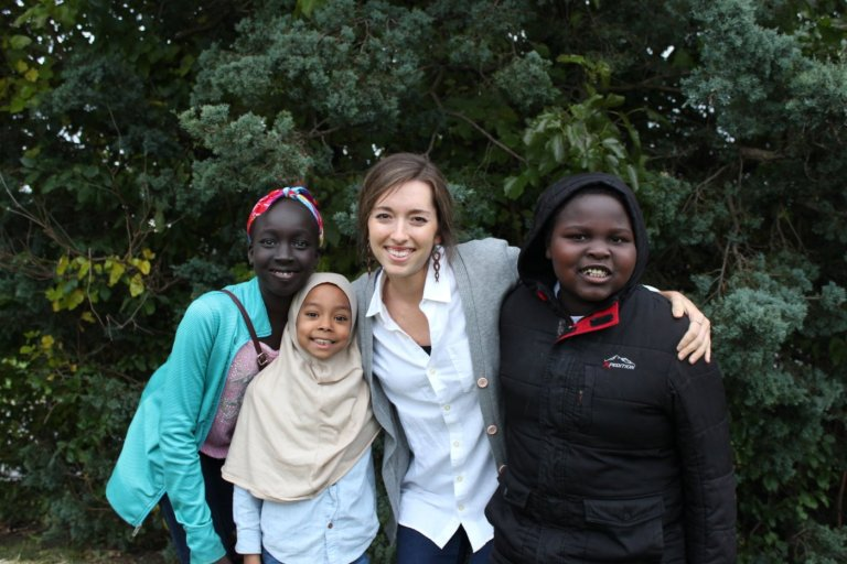 Alison Kummer, student programs coordinator at the Refugee Education Center, with students.