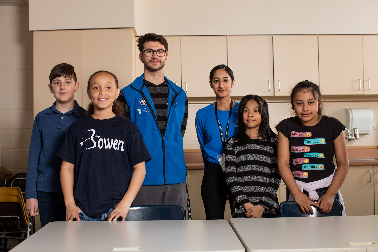 AmeriCorps members Dan Graham and Sharnjit Virk pose with students from Bowen Elementary.
