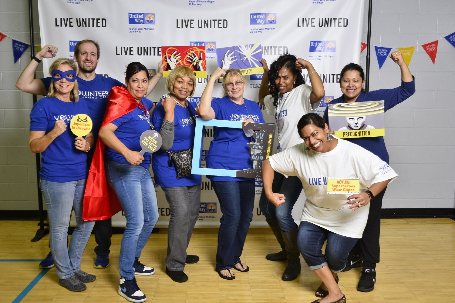 Blue Cross Blue Shield volunteers striking a pose at the Day of Caring lunch.