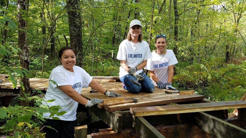 Wolverine Worldwide volunteers building a boardwalk at Howard Christensen Nature Center.