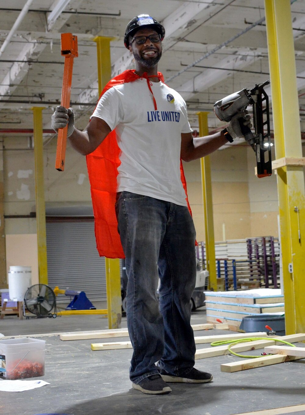Volunteer from Dematic getting into character at Habitat for Humanity of Kent County.