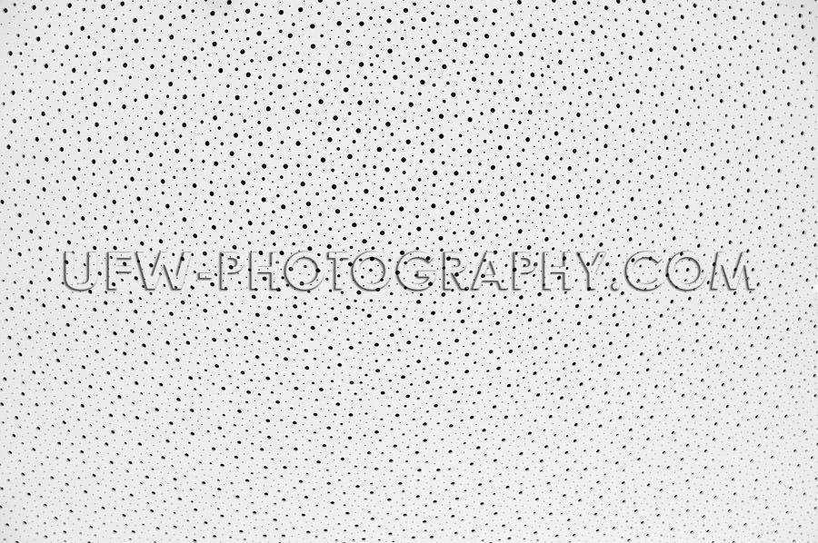 Black holes pattern white abstract background full frame Stock I