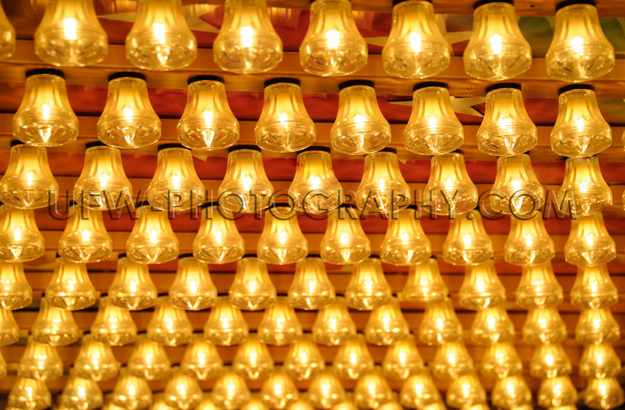 Rows small glowing light bulbs amusement park Stock Image