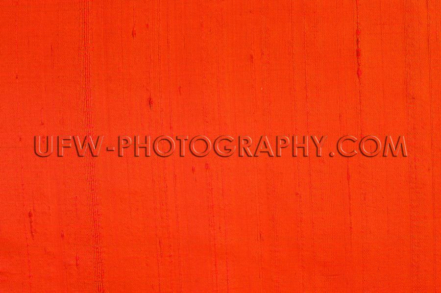 Elegant red silk fabric texture shiny vivid color background Sto