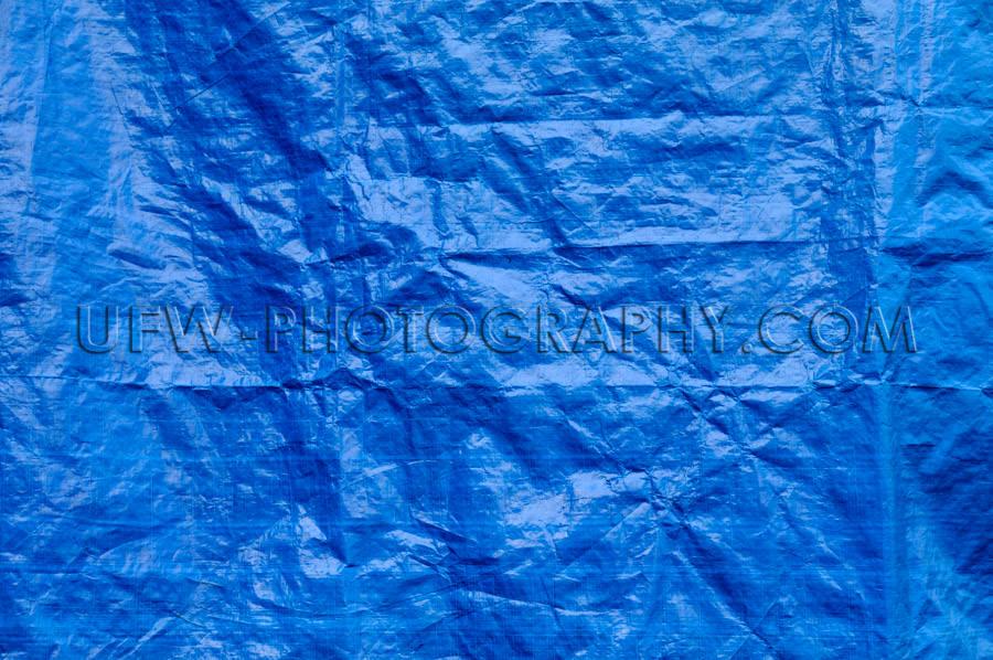 Wrinkled blue tarp texture full frame background Stock Image