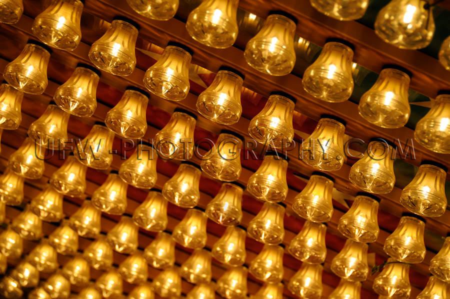 Diagonal pattern rows golden glowing small light bulbs Stock Ima