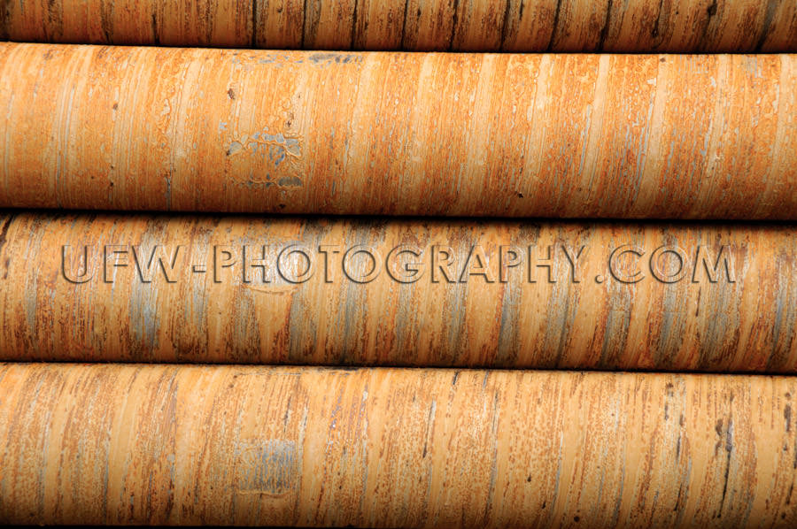 Drilling pipes detail rusty stacked circular pattern background