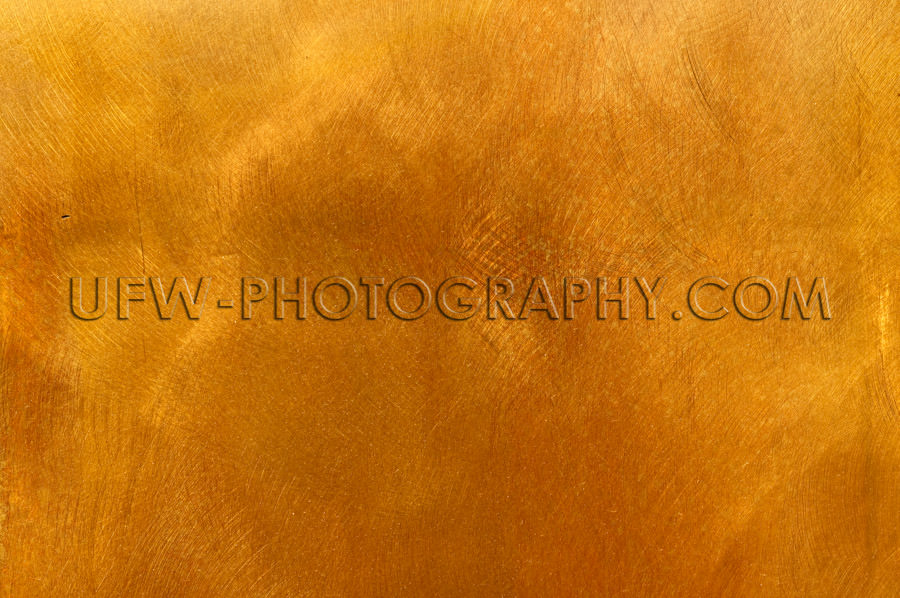Abstract golden brass plate mottled texture for backgrounds Stoc