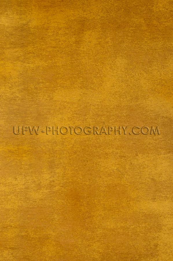Golden wooden background grainy texture full frame Stock Image