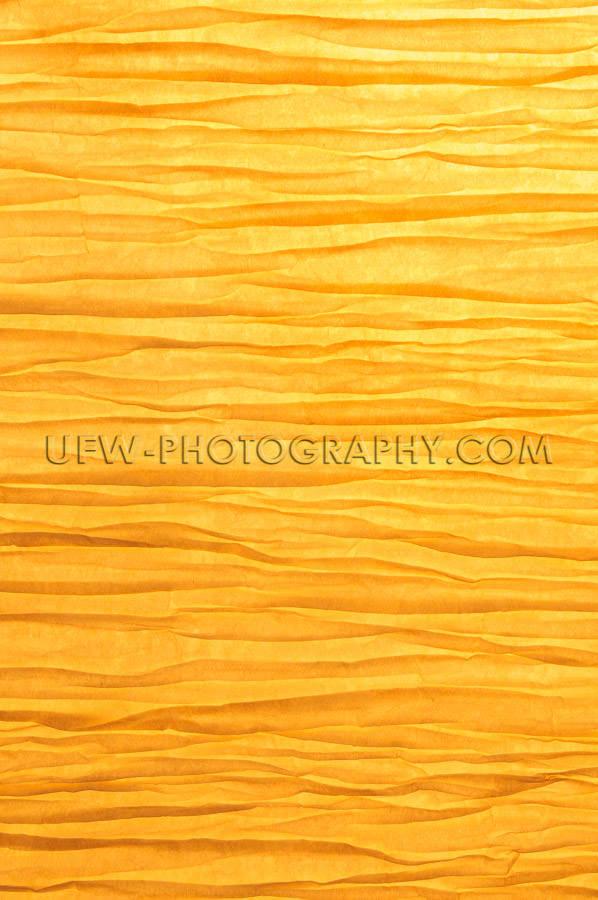 Zen-like wrinkled paper background backlit golden light Stock Im