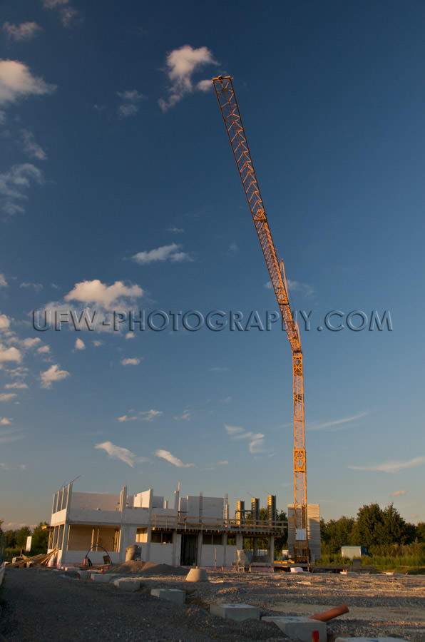Construction crane, shell of an office or residential building -