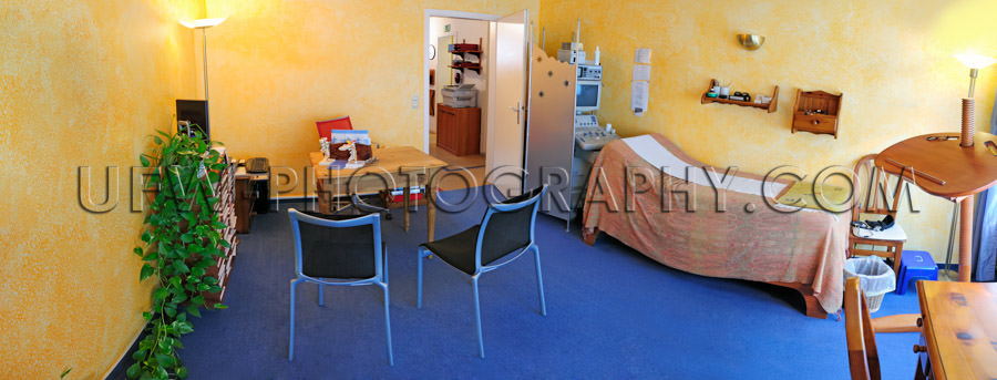 Doctor's office consulting room examination couch yellow blue
