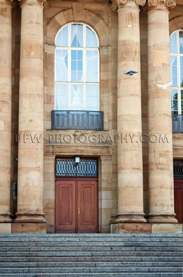 Old theater entrance with columns and arched window Stock Image