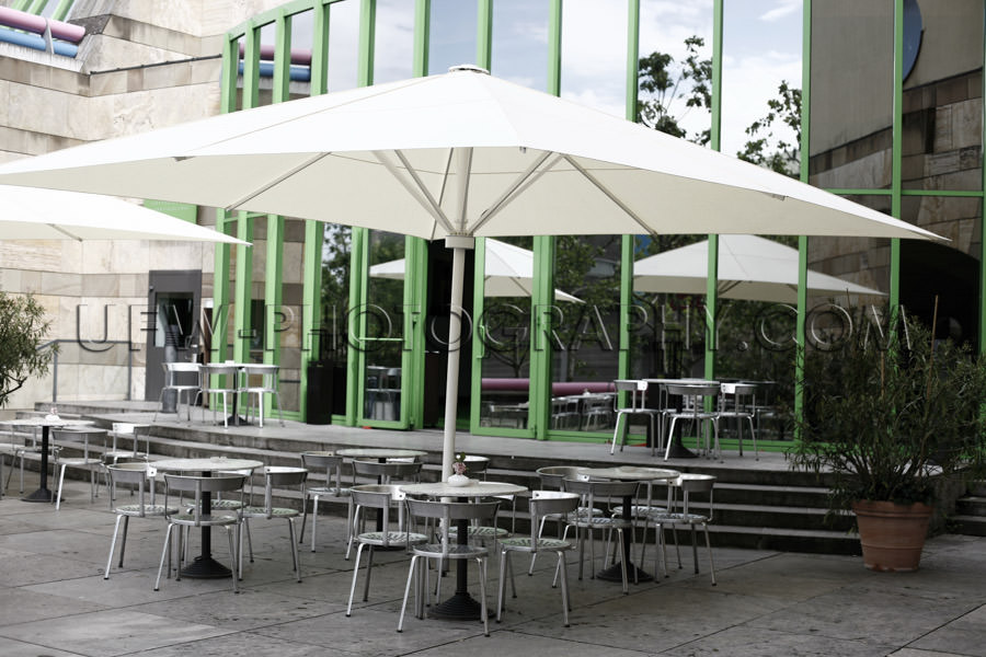 Outdoor cafe patio modern architecture green framed window Stock