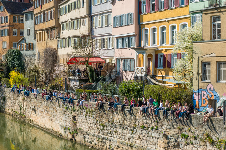 Students sitting on old wall river picturesque medieval universi