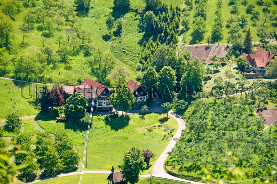 Aerial view beautiful Black Forest valley farm trees meadows Sto