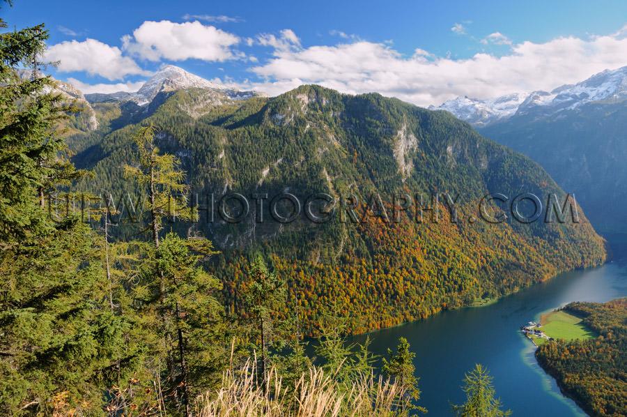 Awesome autumn mountain lake landscape blue cloudy sky Stock Ima