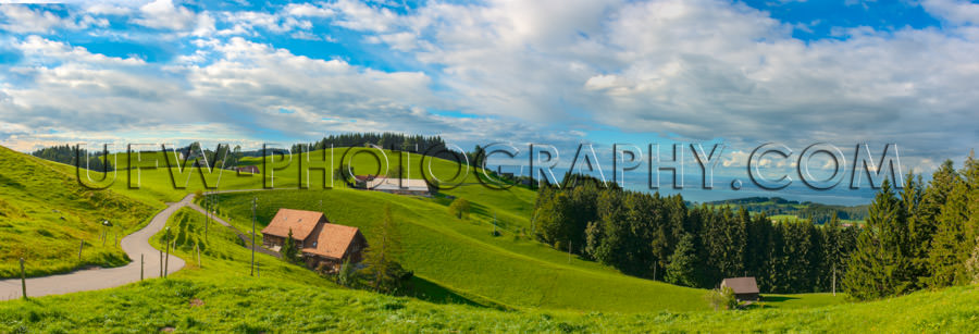Awesome Swiss alpine mountain panorama meadows rolling hills Sto