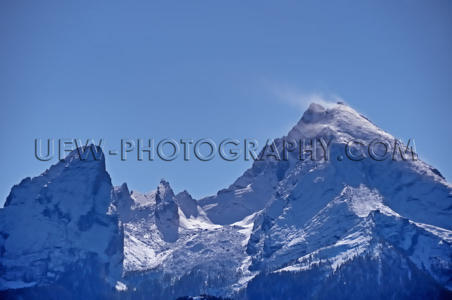 Beautiful snowcapped twin peak mountain against clear blue sky S