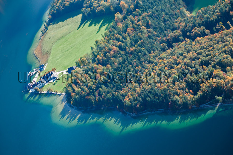 Deep blue lake island autumn forest spectacular aerial view Stoc
