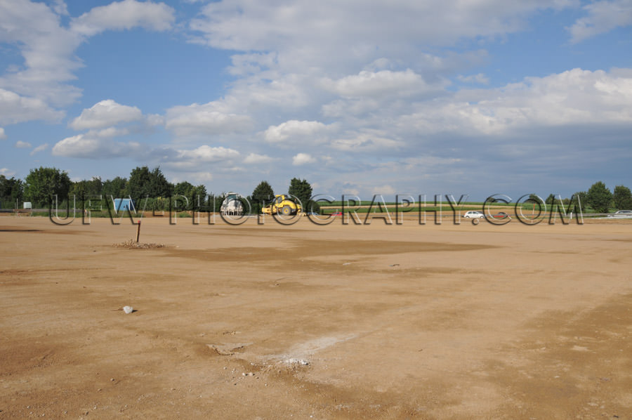 New construction site empty leveled ground farmland had to yield