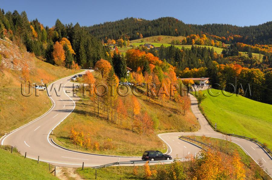Winding mountain road colorful autumn landscape blue sky Stock I