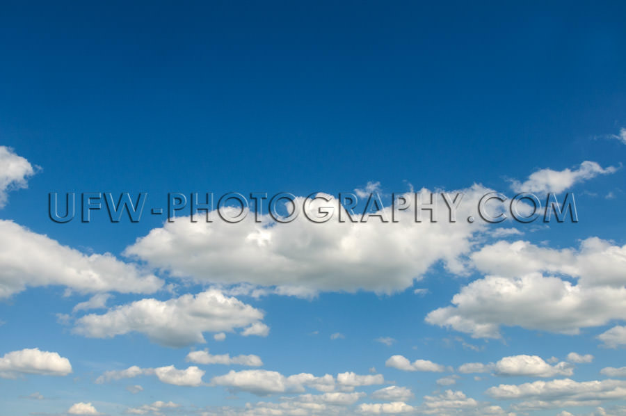 Blue summer sky, scattered clouds - Stock Image
