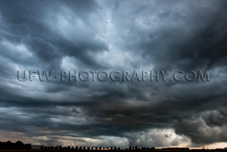 Stormy cloudy sky dramatic dangerous dark gray cloudscape Stock