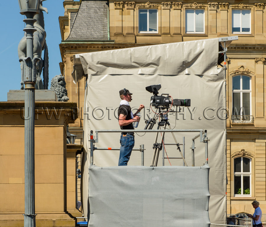 Cameraman tv-camera movie-camera outdoor standing filming Stock