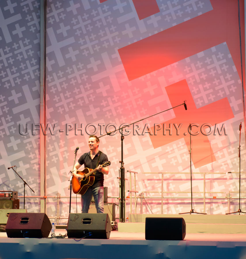 Concert musician singer stage guitar performance Stock Image