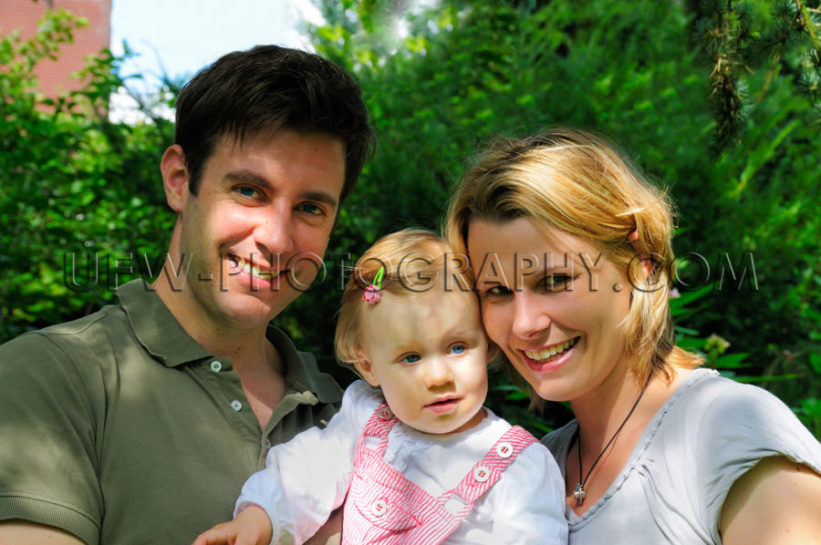 Happy young casual family standing garden dad mom girl toddler S