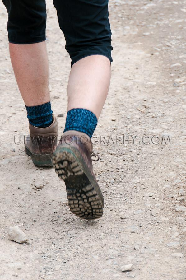 Hiking boots legs calves motion men trail walking Stock Image