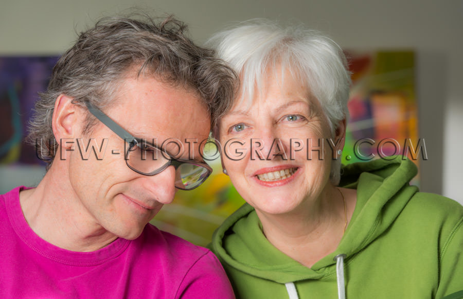 Serene smiling adult couple loving togetherness looking gray hai