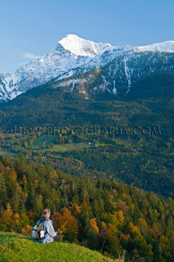 Hiker looking into a beautiful autumn colored mountain valley St