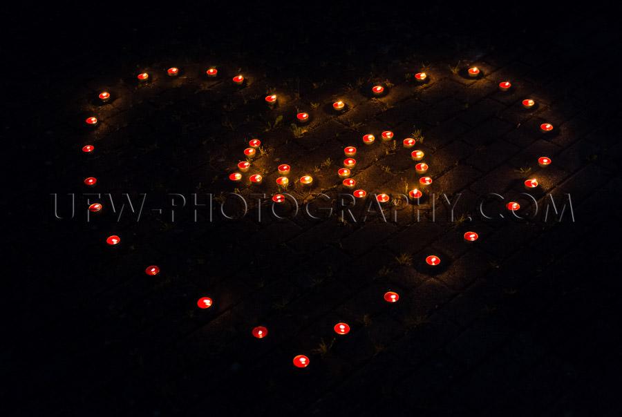 Burning tea light candles night heart-shape number 40 celebratio