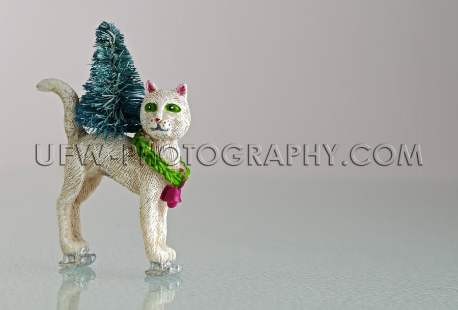 Fancy skating christmas cat figurine on ice Stock Image