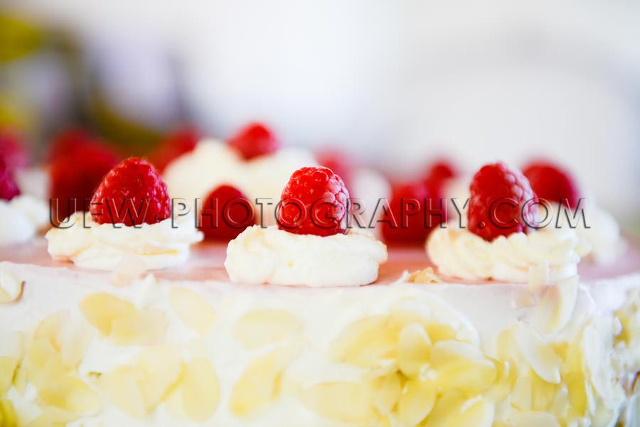 Raspberry cream cake close-up rich decorated full frame Stock Im
